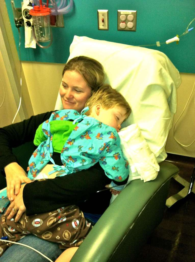 The author holds her son after his first major surgery